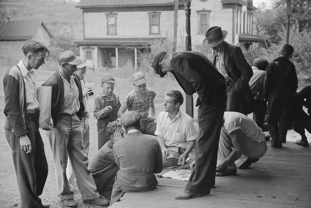 miners gathered on a porch in the 1930s